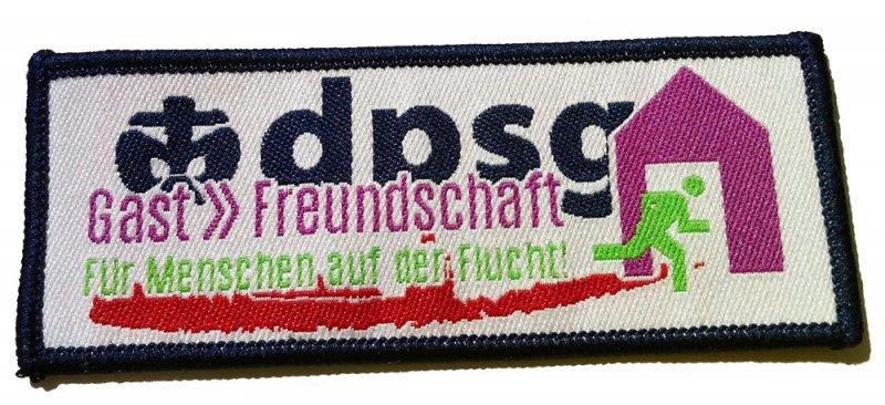 http://scoutladen.eu/shop/bilder/produkte/gross/Gastfreundschaft-Aufnaeher-85-x-30-mm.jpg